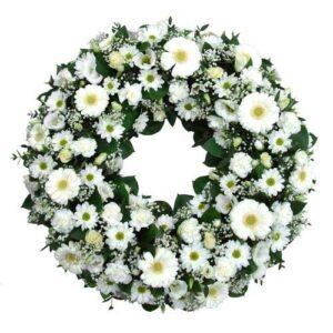 corona funebre bianca e verde con fiori misti
