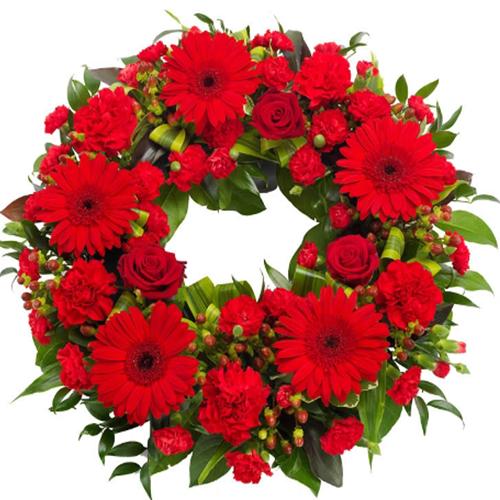 corona funebre fiori misti sulle tonalità del rosso